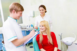 Dentist talking to patient about dentla insurance